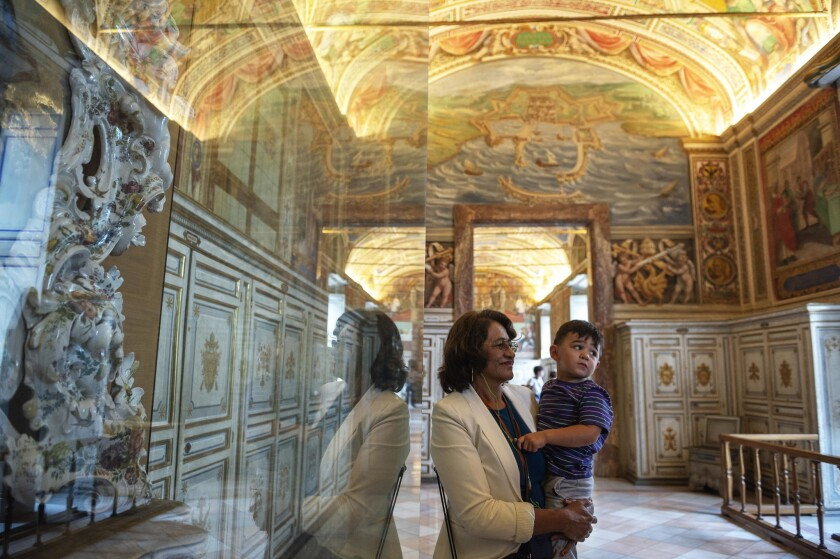 Maria Hilda Gonzalez and her 2-year-old grandson, Liam, visit the Vatican Museums in Vatican City on Thursday.