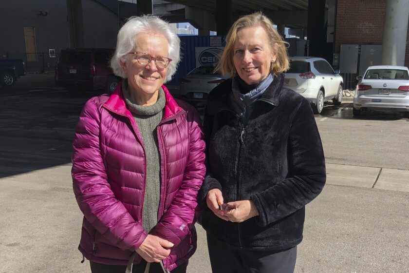Linda Rosales, left, and Linda Dee pose for a photo after they carpooled to a campaign event with Sen. Amy Klobuchar, D-Minn., in Denver on March 2, 2020, only to find she had ended her presidential bid. The two had hoped to back a woman but are accepting the Democratic race will come down to two white men. (AP Photo/Nicholas Riccardi)