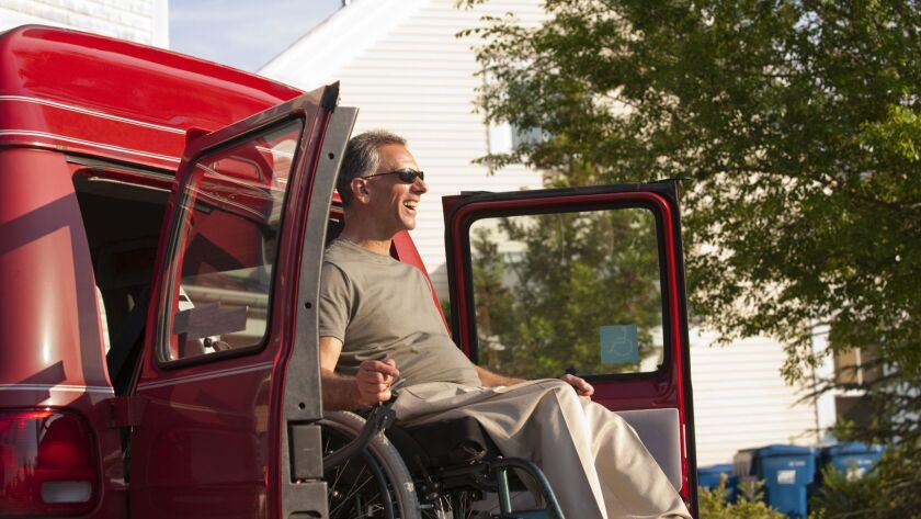 Wheelchair Accessible Vans For Rent In California, Man In Wheelchair Being Lowered From Accessible Van, Wheelchair Accessible Vans For Rent In California