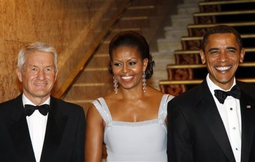Thorbjon Jagland, head of the Nobel committee, First Lady Michelle Obama and US President Barack Obama at a banquet in Obama's honor in Oslo, Thursday, Dec. 10, 2009. (AP Photo/Lise Aserud, Scanpix)