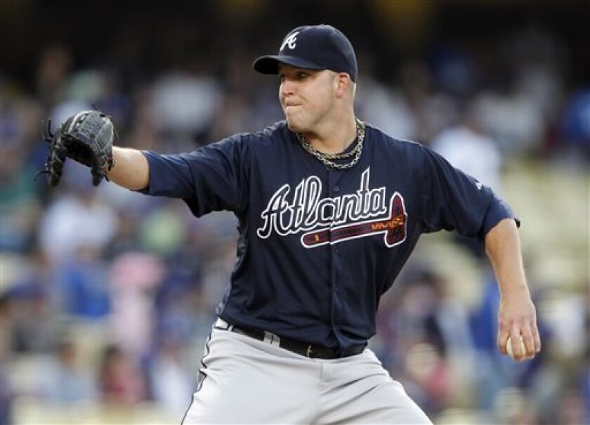 Atlanta Braves starting pitcher Paul Maholm throws to a Los Angeles Dodgers batter during the first inning of a baseball game Friday, June 7, 2013, in Los Angeles. (AP Photo/Alex Gallardo)