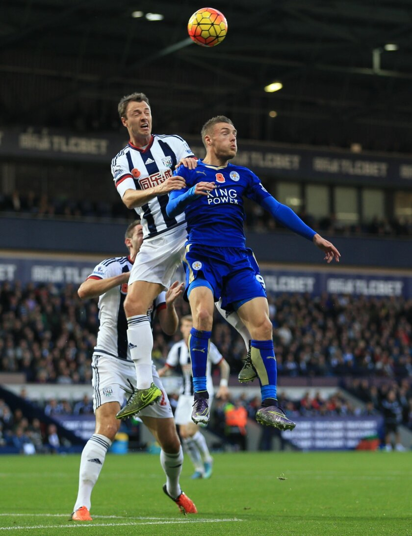 West Bromwich Albion's Jonny Evans, left, and Leicester City's Jamie Vardy battle for the ball during their English Premier League soccer match at The Hawthorns, West Bromwich, England, Saturday, Oct. 31, 2015. (Nigel French/PA via AP)     UNITED KINGDOM OUT      -     NO SALES      -     NO ARCHIV
