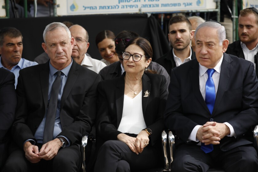 Blue and White party leader Benny Gantz, left, Supreme Court Chief Justice Esther Hayut and Prime Minister Benjamin Netanyahu.