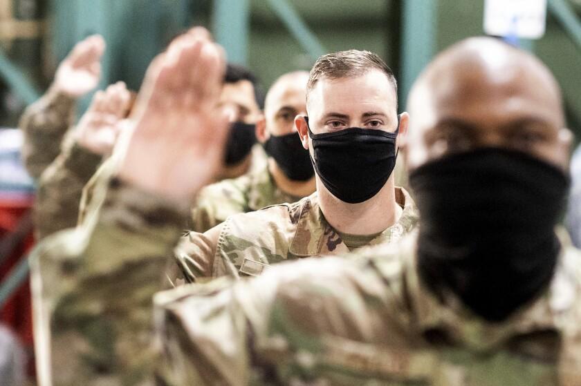 U.S. military members take an oath