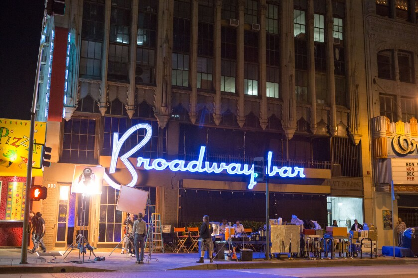 """A crew for Screen Gems' film """"About Last Night"""" works on a night exterior set on Broadway in downtown Los Angeles."""