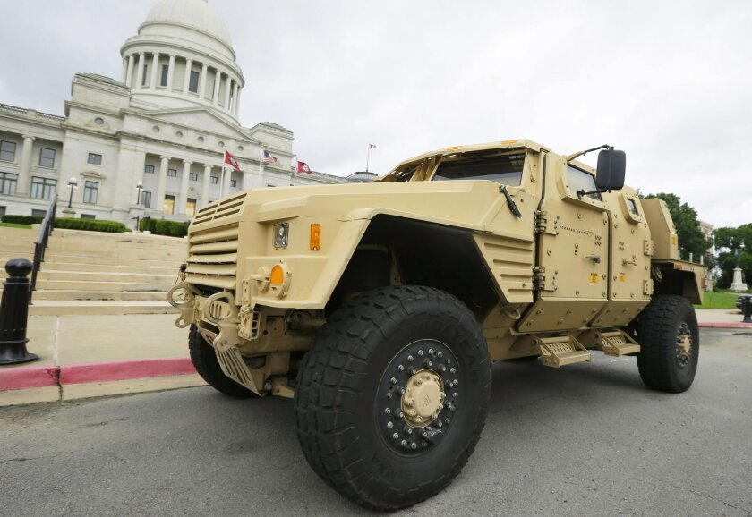 FILE - In this file photo taken May 26, 2015, a prototype of a Lockheed Martin Joint Light Tactical Vehicle is parked in front of the Arkansas state Capitol in Little Rock, Ark. The Department of Defense announced Tuesday, Aug. 25, 2015, that the defense contract to produce the vehicle is going to Wisconsin-based Oshkosh Corp. (AP Photo/Danny Johnston, File)