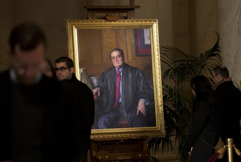 People line up to pay respects to late Justice Antonin Scalia in the Great Hall of the Supreme Court in Washington, where Scalia's body lies in repose.