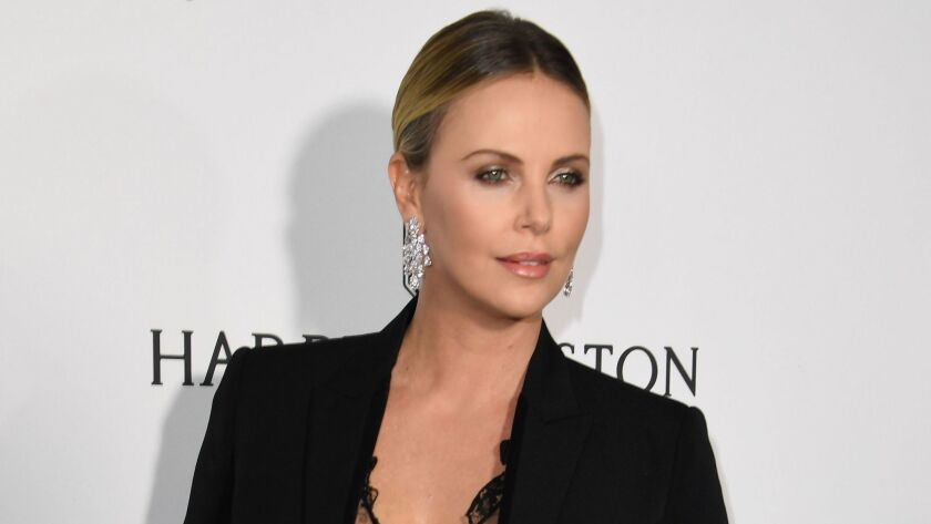 Honoree Charlize Theron arrives for amfAR's Inspiration Gala Los Angeles at Milk Studios.