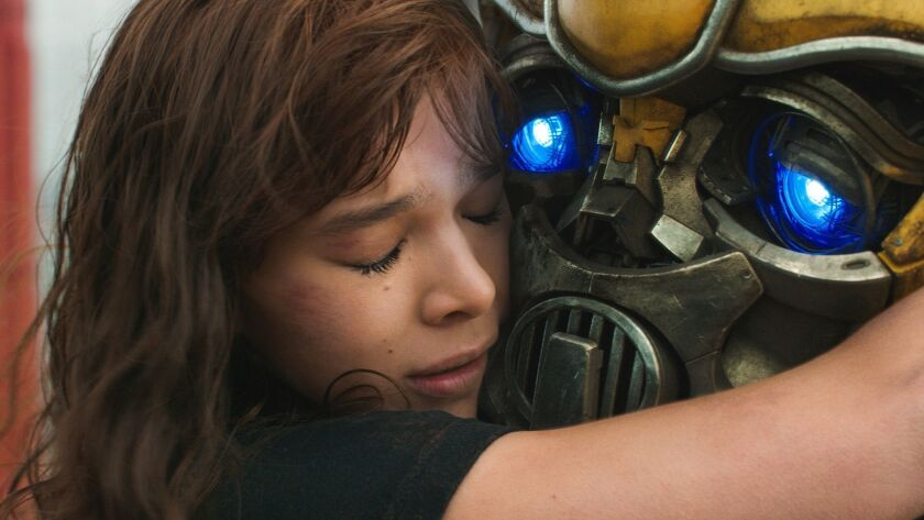 """Left to right: Hailee Steinfeld as Charlie and Bumblebee in """"BUMBLEBEE,"""" from Paramount Pictures. Cr"""