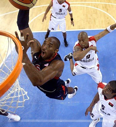 Team USA forward Kobe Bryant goes for a dunk as Angola players Armando Costa (5), Vladimir Jeronimo (9) and Carlos Morais (6) look on during their preliminary basketball game in Beijing. The U.S. won, 97-76.