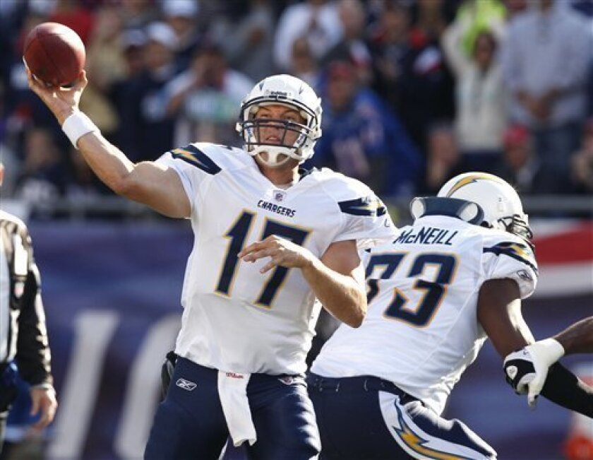 San Diego Chargers quarterback Philip Rivers (17) passes the ball under protection from tackle Marcus McNeill (73) in the first quarter of the Chargers' NFL football game against the New England Patriots in Foxborough, Mass., Sunday, Sept. 18, 2011. (AP Photo/Charles Krupa)