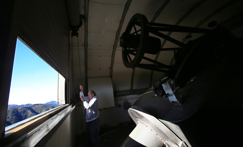 Gordon Jones of the Monterey Institute for Research in Astronomy looks out from telescope tower of the station.