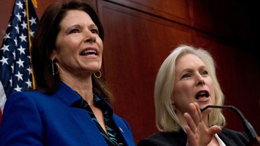 Rep. Cheri Bustos (D-Ill.), left, and Sen. Kirsten Gillibrand (D-N.Y.) discuss proposed sexual harassment legislation.