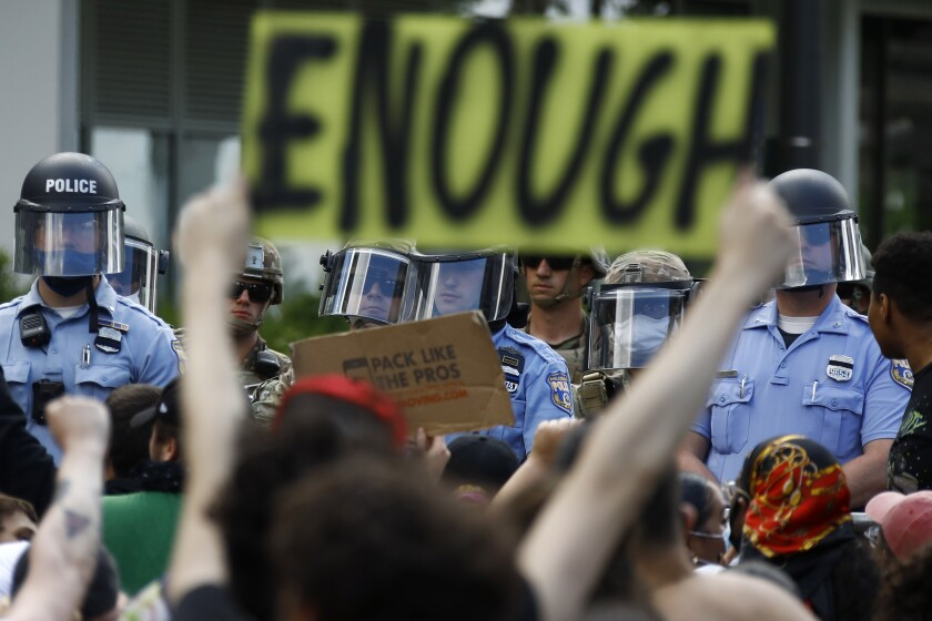 FILE - In this June 1, 2020, file photo, protesters rally as Philadelphia Police officers and Pennsylvania National Guard soldiers look on in Philadelphia, over the death of George Floyd, a black man who was in police custody in Minneapolis. (AP Photo/Matt Slocum, File)