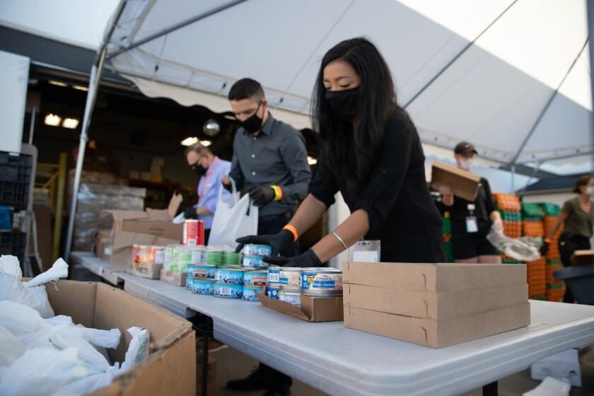 Jewish Family Service team members prepare their daily weekday drive-thru food distribution.