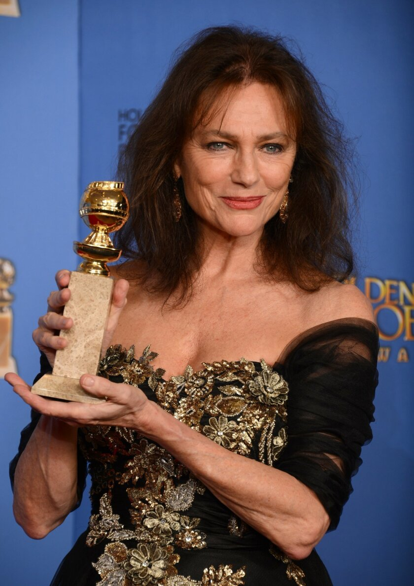 """Jacqueline Bisset poses in the press room with the award for best supporting actress in a series, mini-series or motion picture made for television for """"Dancing on the Edge"""" at the 71st annual Golden Globe Awards at the Beverly Hilton Hotel on Sunday, Jan. 12, 2014, in Beverly Hills, Calif. (Photo by Jordan Strauss/Invision/AP)"""
