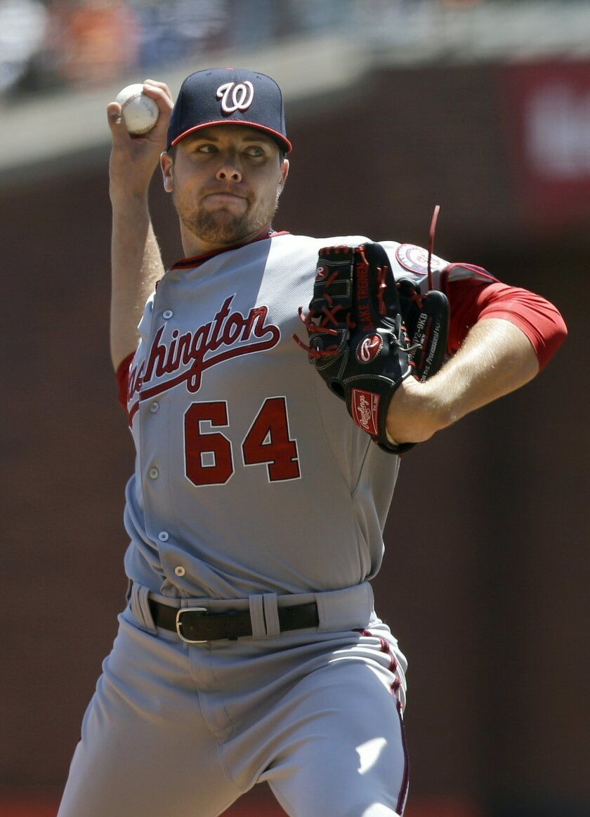 Washington Nationals pitcher Blake Treinen (64) throws against the San Francisco Giants during the first inning of a baseball game in San Francisco, Thursday, June 12, 2014. (AP Photo/Jeff Chiu)