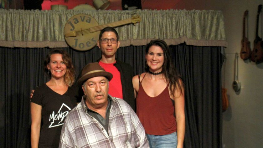 Java Joe Flammini (in hat) and his Open Mic hosts (from left, Gaby Aparicio, Stephan Boudouris and Nina Francis.