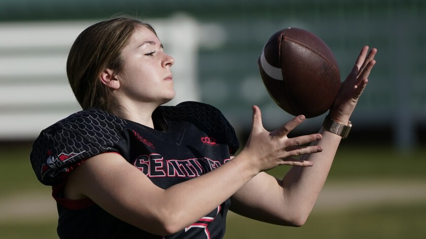 FILE - Sam Gordon catches a football in Herriman, Utah, in this Oct. 20, 2020, file photo. A federal judge ruled against Gordon on Monday, March 1, 2021, finding that Utah school districts don't have to offer separate football teams for girls. (AP Photo/Rick Bowmer, File)