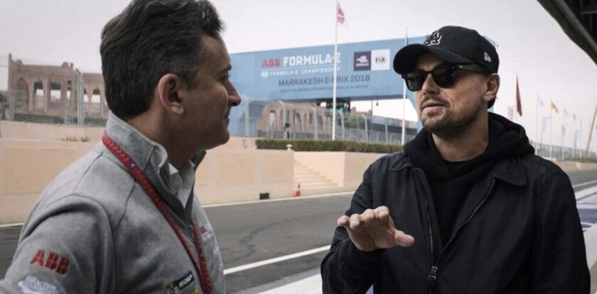 """In this handout provided by Formula E Operations Limited, Alejandro Agag, left, and Leonardo DiCaprio appear in a scene from the film """"And We Go Green."""" (Malcolm Venville, Formula E Operations Limited via AP)"""
