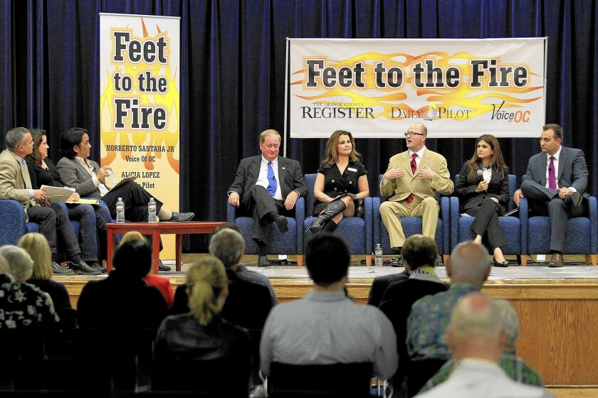 Candidates for the 74th Assembly District, from right, Emanuel Patrascu, Anila Ali, Matthew Harper, Karina Onofre and Keith Curry address questions by panelists, from left, Norberto Santana Jr., Alicia Lopez and Jack Wu during the Feet to the Fire Forum in Costa Mesa on Thursday.