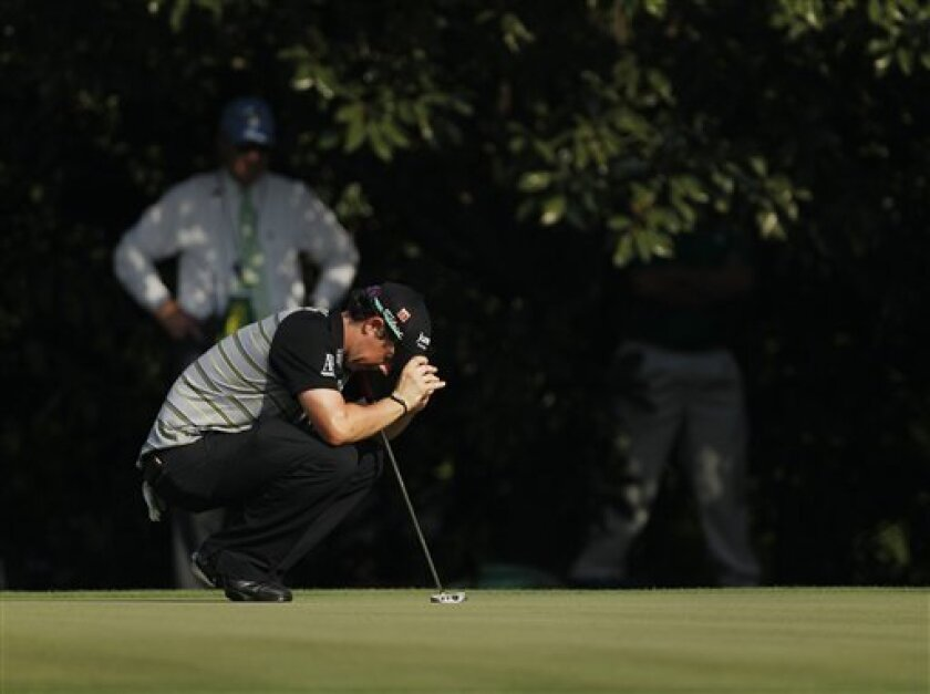 Rory McIlroy of Northern Ireland reacts after missing a putt on the 11th hole during the final round of the Masters golf tournament Sunday, April 10, 2011, in Augusta, Ga. (AP Photo/Matt Slocum)