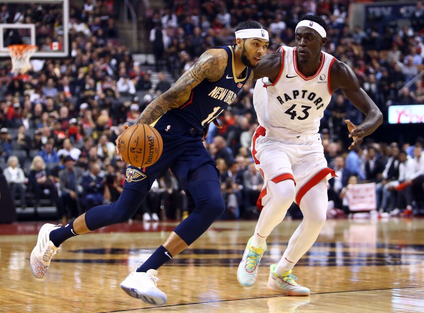 Pelicans forward Brandon Ingram drives past Raptors forward Pascal Siakam during the first half of a game on Oct. 22, 2019, in Toronto.