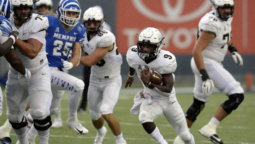 Central Florida running back Adrian Killins Jr. (9) runs the ball against Memphis during the second