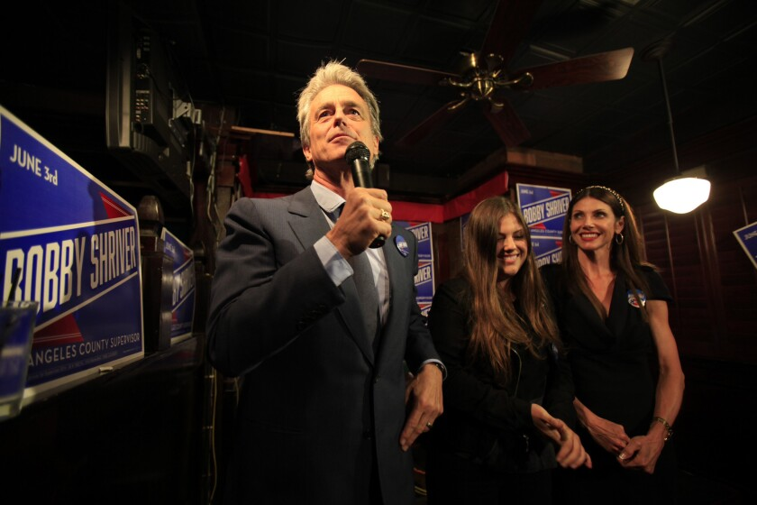 Bobby Shriver, left, daughter Natasha Hunt Lee, center and wife Malissa Shriver, greet the crowd during an election night party for the Los Angeles County Board of Supervisor's race at O'Brien's Irish Pub in Santa Monica.