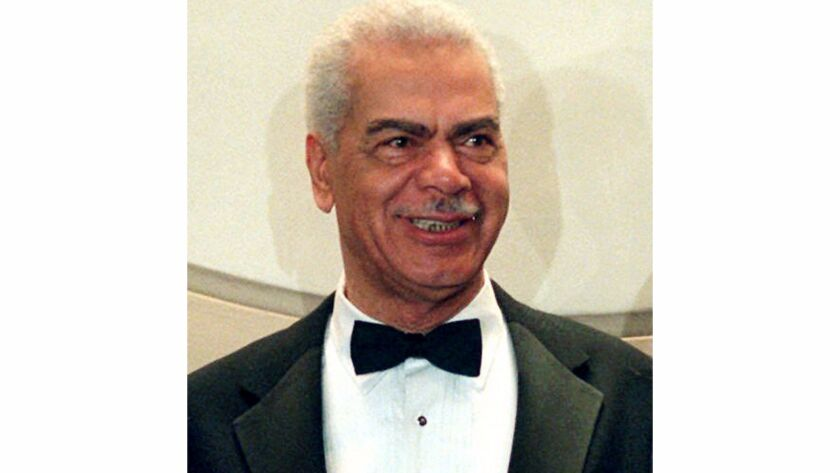 FILE - In this Feb. 3, 1997, file photo, Earle Hyman poses before an induction to the Theater Hall o
