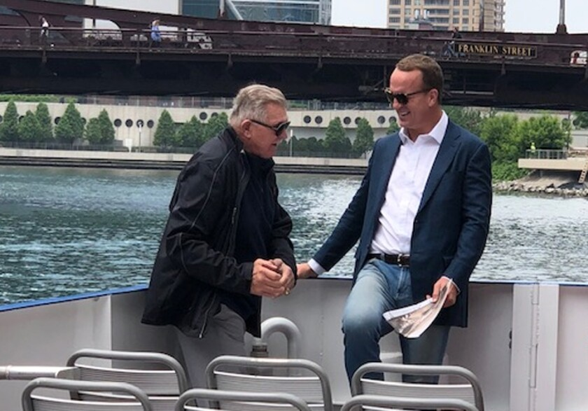 Peyton Manning, right, hangs out with legendary Bears coach Mike Ditka on the Chicago River.