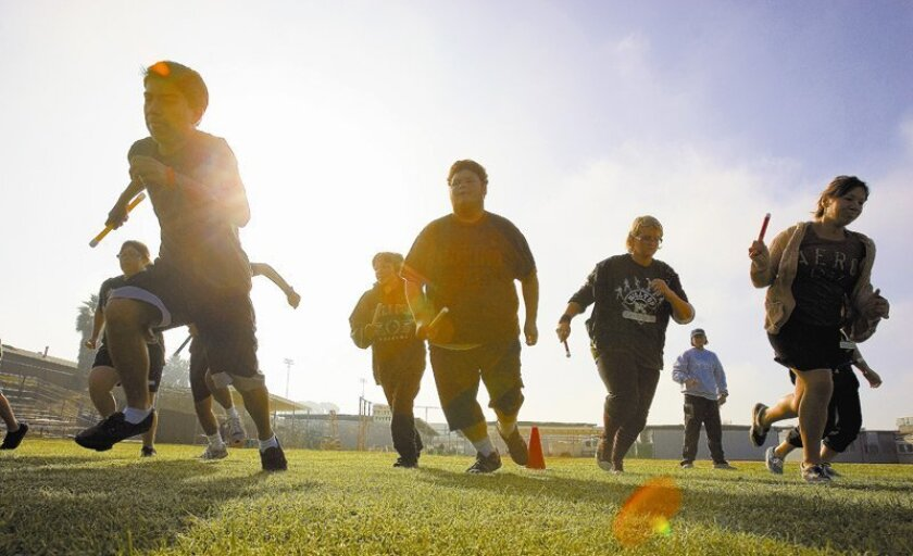 Students at Hilltop High School began a short relay run during P.E. class. The Sweetwater Union High School District received a $1.1 million federal grant to combat teenage obesity. The money will be used to train teachers in fitness standards and to buy high-tech fitness equipment.