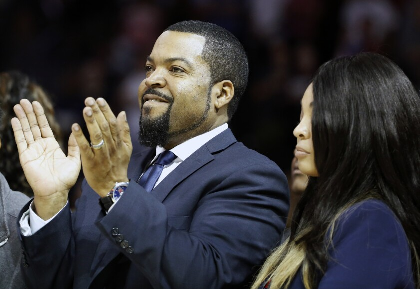 FILE - In this June 25, 2017, file photo, Big3 Basketball League founder Ice Cube applauds the crowd during a timeout in the first half of Game 2 in the league's debut at the Barclays Center in New York. Ice Cube is still looking to take his 3-on-3 basketball league to greater heights in its fourth season of play. The Big3 took the summer of 2020 off because of the pandemic. (AP Photo/Kathy Willens, File)