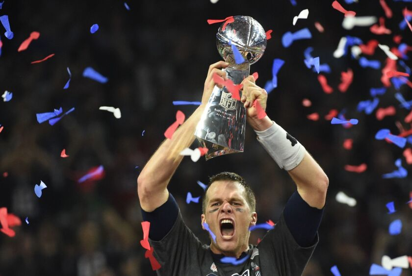 Tom Brady of the New England Patriots holds the Vince Lombardi Trophy on Sunday.