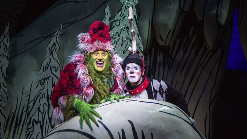 (from left) Edward Watts appears as The Grinch and Dan DeLuca as Young Max in Dr. Seuss's How the Gr