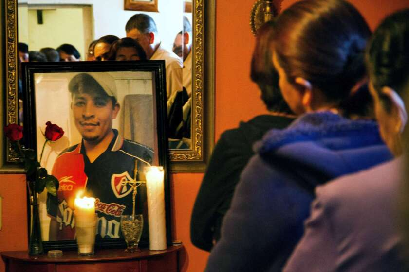 Relatives and friends of Ruben Garcia Villalpando, a immigrant who was killed by police in Texas, take part in a Mass at his sister's house in Nuevo Porvenir, Mexico, on Feb. 28.