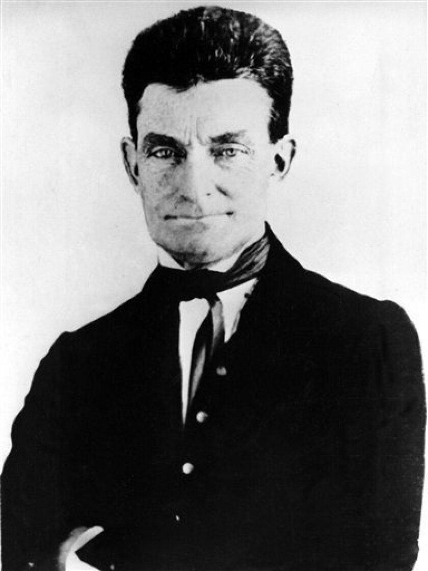FILE - John Brown, leader of the historic raid on the federal arsenal and armory at Harpers Ferry, Virginia, is seen in this 1857 picture.   An important piece of Civil War history is going on the auction block, the 19th century mansion that sits on the  land where abolitionist John Brown was hange