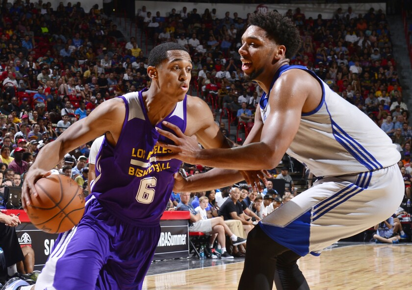 The Lakers' Jordan Clarkson, left, drives against Philadelphia during summer league play in Las Vegas on July 11.