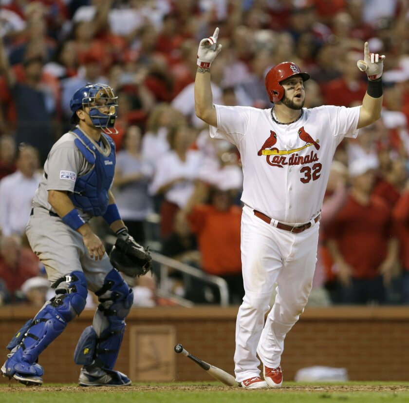 FILE - In this Tuesday, Oct. 7, 2014 file photo, St. Louis Cardinals first baseman Matt Adams celebrates after hitting a three-run home in the seventh inning of Game 4 of baseball's NL Division Series against the Los Angeles Dodgers in St. Louis. Building largely from within in the free-agent era, St. Louis topped the 10 postseason teams with 17 homegrown players on its 25-man division series according to STATS. Adams, who hit the three-run homer in Game 4 on Tuesday cost just $25,000 to sign when the Cardinals drafted him on the 23rd round in 2009. (AP Photo/Jeff Roberson, File)