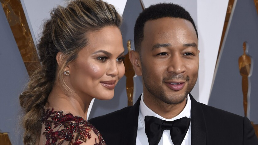 Chrissy Teigen and John Legend at the Academy Awards in February 2016.