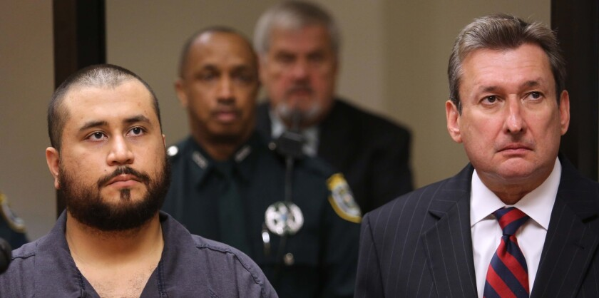 George Zimmerman, the acquitted shooter in the death of Trayvon Martin, stands with his defense counsel, Jeff Dowdy, during a first-appearance hearing on charges including aggravated assault stemming from a fight with his girlfriend Nov. 19 in Sanford, Fla.