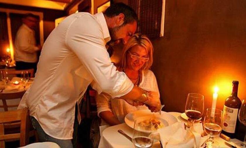Paulo Cesaro shaves truffles over a pasta dish at Ado for Jo Ellen Sessa of Phoenix.