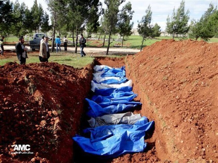 This citizen journalism image provided by Aleppo Media Center AMC which has been authenticated based on its contents and other AP reporting, shows a mass burial of people allegedly killed by Syrian Army snipers, in Aleppo, Syria, Wednesday, April 17, 2013. On Tuesday, the Syrian Red Crescent recove