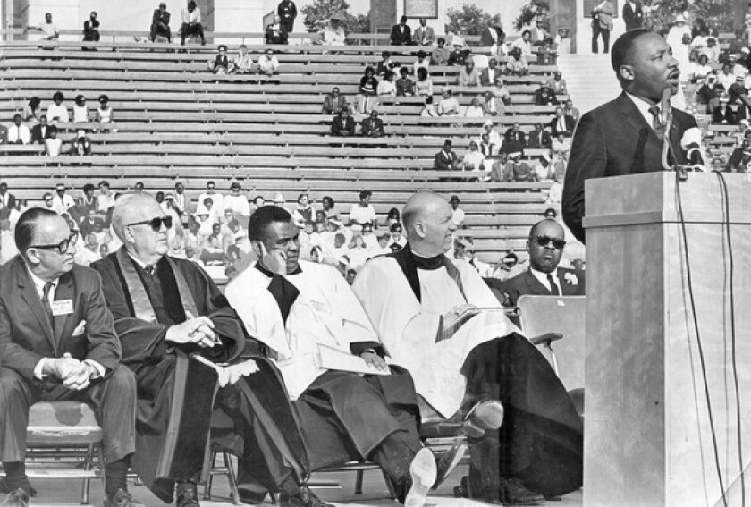 The Rev. John Burt, seated at far right, listens as Martin Luther King Jr. addresses 15,000 people at the Coliseum during an interfaith rally in 1964. Burt helped organize massive civil rights rallies in Los Angeles.