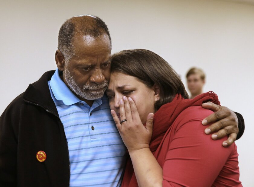 "Nicki Mehta, right, a lecturer at California State University, Sacramento, wipes away ""tears of joy"" as she is hugged by CSUS Criminal Justice Professor Cecil Canton, after a salary agreement was announced between CSU faculty members and the California State University system, after a news conferen"