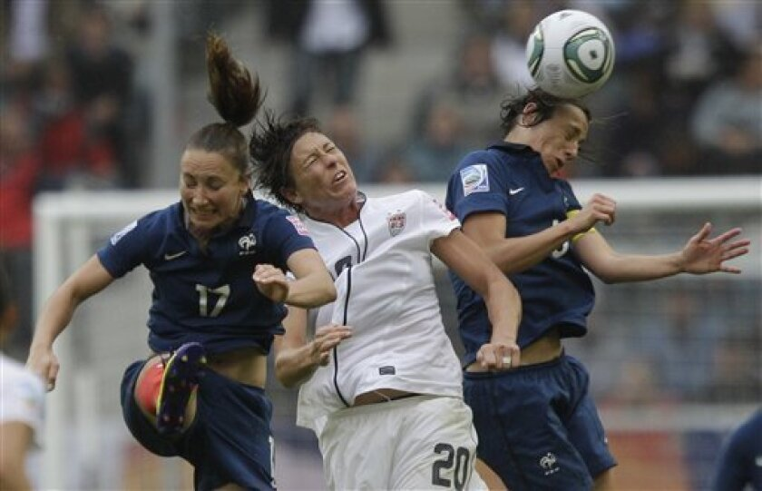 From left, France's Gaetane Thiney, United States' Abby Wambach and France's Sandrine Soubeyrand go for the ball during the semifinal match between France and the United States at the Women's Soccer World Cup in Moenchengladbach, Germany, Wednesday, July 13, 2011. (AP Photo/Marcio Jose Sanchez)