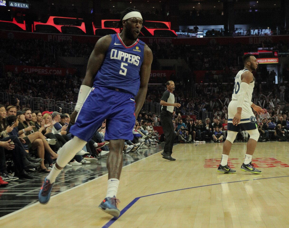 LOS ANGELES, CA - FEBRUARY 1, 2020: LA Clippers forward Montrezl Harrell (5) reacts after scoring on a break-away slam dunk against the Minnesota Timberwolves in the second half at Staples Center on February 1, 2020 in Los Angeles, California.(Gina Ferazzi/Los AngelesTimes)