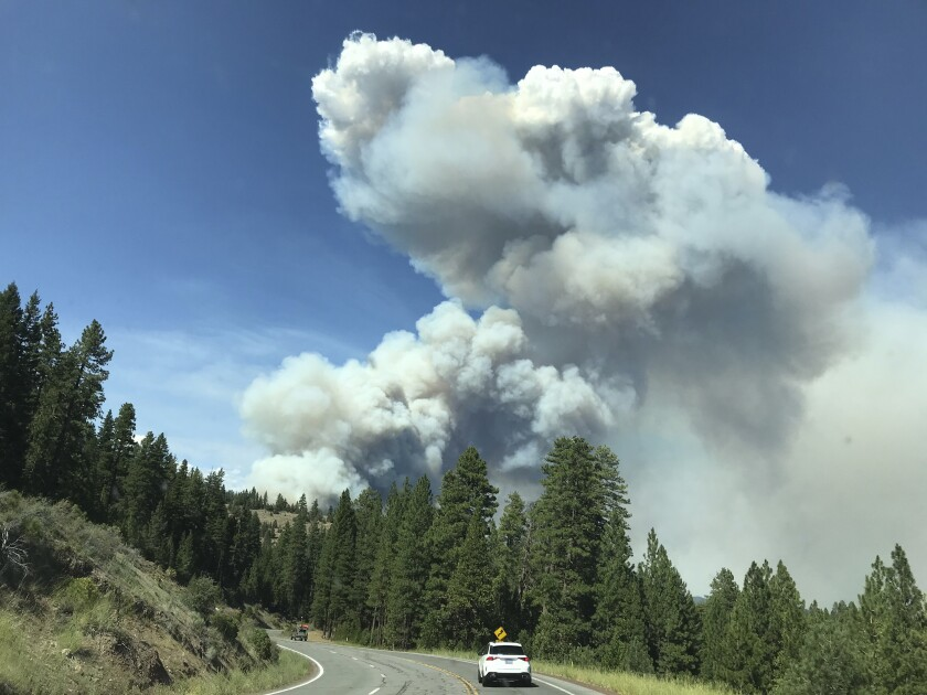 Smoke from the Hog Fire is seen from Highway 36 west of Susanville, California