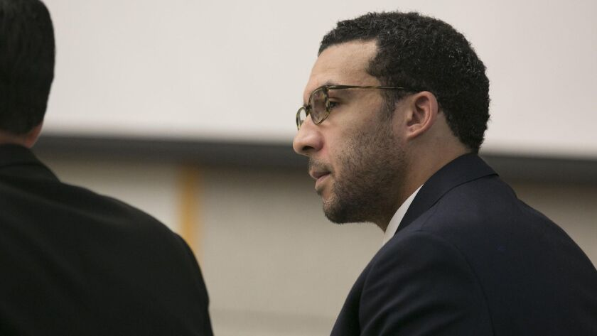 Former NFL football player Kellen Winslow Jr. looks at attorney Marc Carlos during his rape trial on Monday in Vista, Calif.