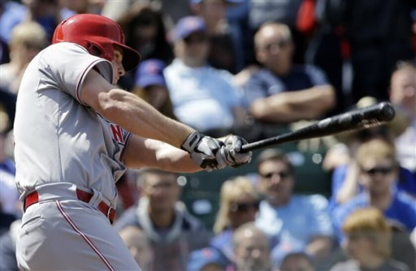 Cincinnati Reds' Jay Bruce hits a one-run double against the Chicago Cubs during the fourth inning of a baseball game in Chicago, Sunday, May 5, 2013. (AP Photo/Nam Y. Huh)
